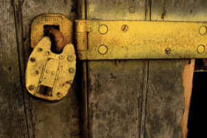 Padlock on wood door